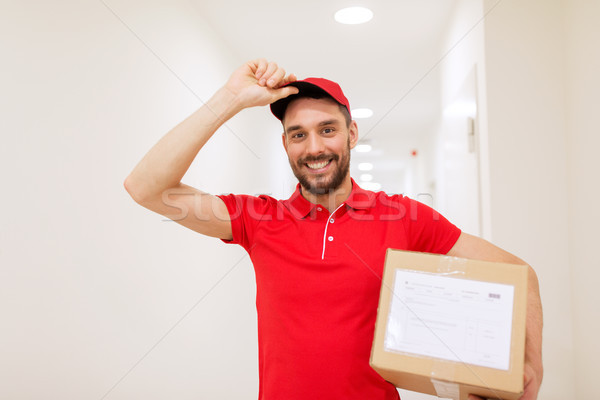 delivery man with parcel box in corridor Stock photo © dolgachov