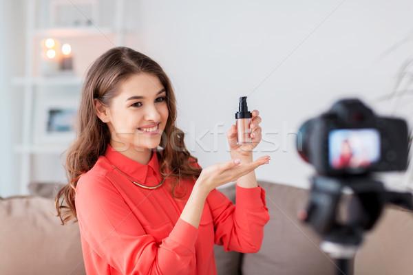 woman with foundation and camera recording video Stock photo © dolgachov