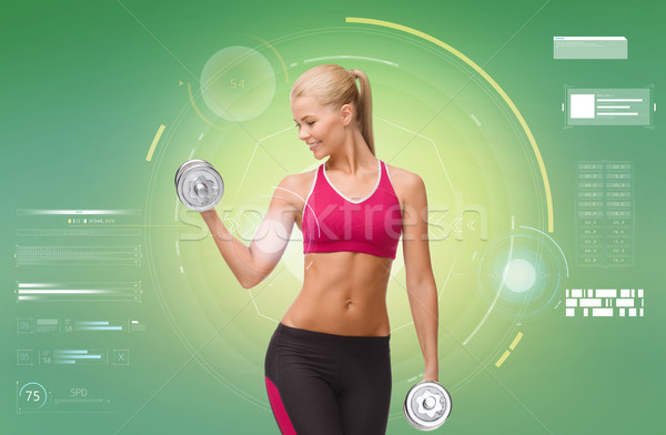 Stock photo: happy sporty woman with dumbbells flexing biceps