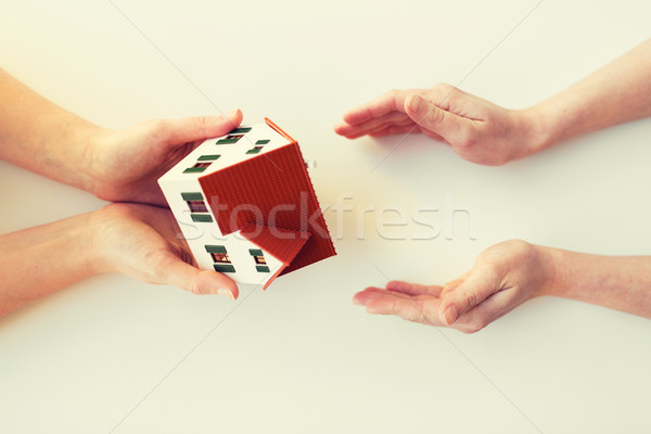 close up of hands giving house or home model Stock photo © dolgachov