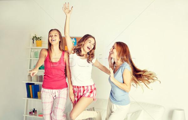 happy friends or teen girls having fun at home Stock photo © dolgachov