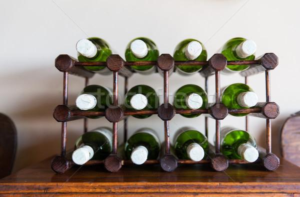 Fehérbor üvegek fából készült fogas raktár borászat Stock fotó © dolgachov