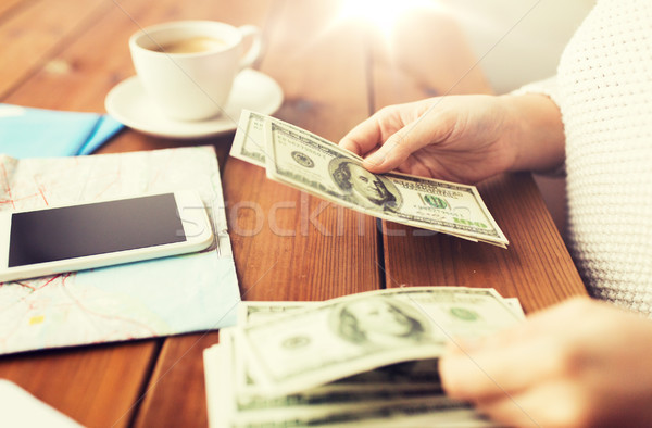 close up of traveler hands counting dollar money Stock photo © dolgachov
