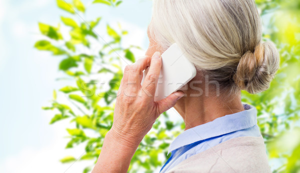 close up of senior woman calling on smartphone Stock photo © dolgachov