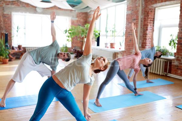 группа людей йога треугольник создают студию фитнес Сток-фото © dolgachov