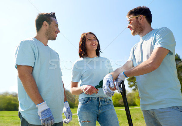 group of volunteers with garden tools in park Stock photo © dolgachov