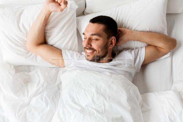 Férfi ágy otthon emberek boldog fiatal Stock fotó © dolgachov