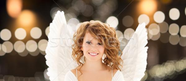 Boldog nő angyalszárnyak karácsony fények ünnepek Stock fotó © dolgachov