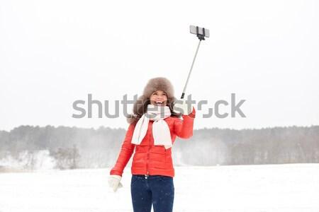 счастливым женщину зима мех Hat улице Сток-фото © dolgachov