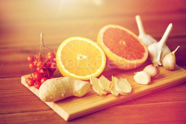 citrus, ginger, garlic and rowanberry on wood Stock photo © dolgachov