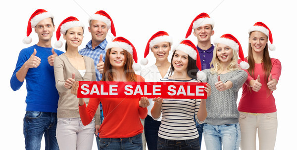 Stock photo: people with shopping bags at christmas sale