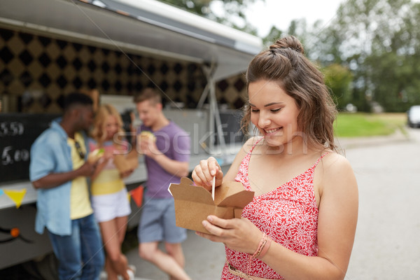 happy woman with wok and friends at food truck Stock photo © dolgachov