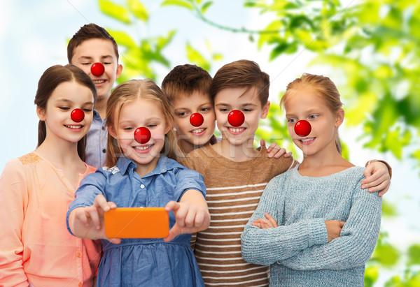 Ragazzi smartphone rosso naso giorno Foto d'archivio © dolgachov
