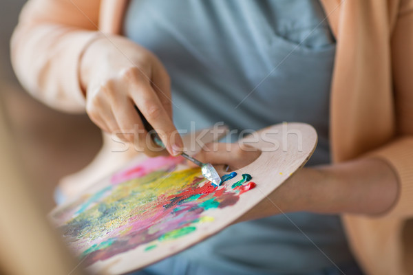 artist with palette knife painting at art studio Stock photo © dolgachov