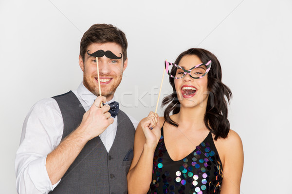 happy couple with party props having fun Stock photo © dolgachov