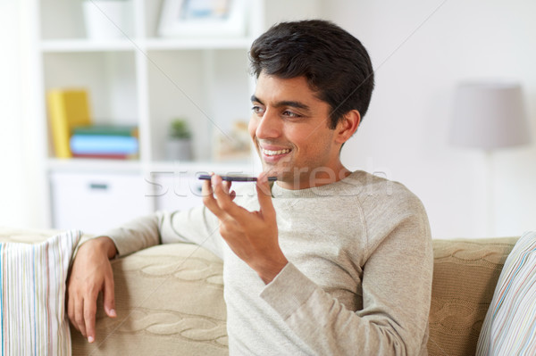 man using voice command recorder on smartphone Stock photo © dolgachov