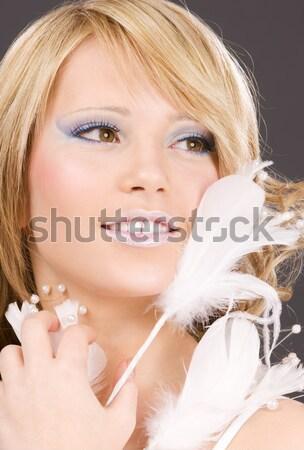 smiling blond in furry headphones Stock photo © dolgachov