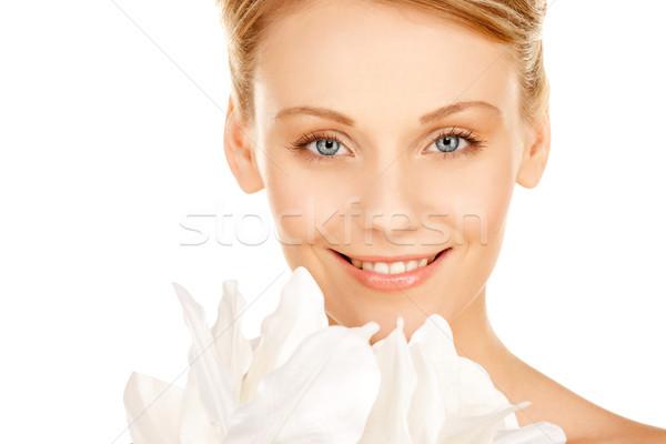 beautiful woman with madonna lily Stock photo © dolgachov