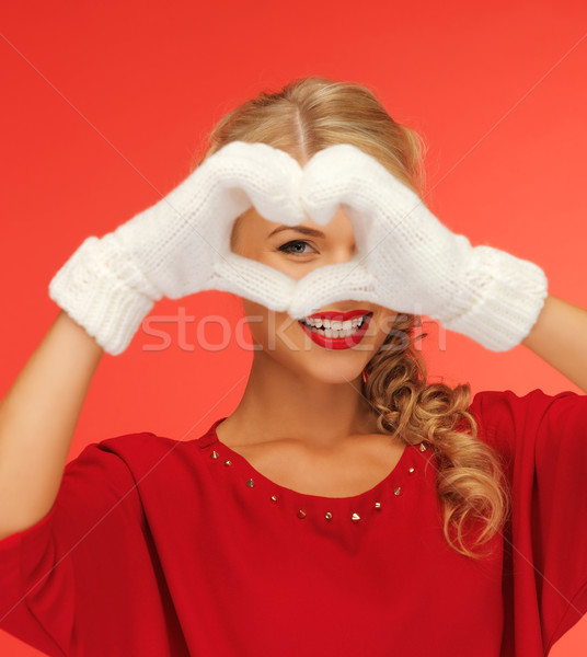 lovely woman showing heart shape Stock photo © dolgachov