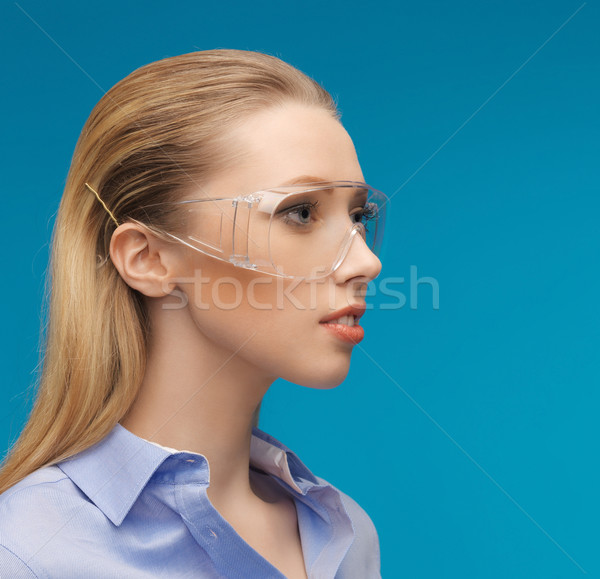 businesswoman in protective glasses Stock photo © dolgachov