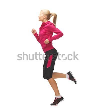 ストックフォト: スポーティー · 女性 · を実行して · ジャンプ · 画像 · 美しい