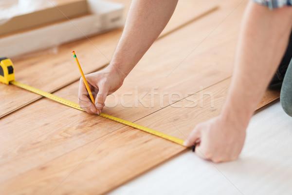 Männlich Hände Holz Bodenbelag Stock foto © dolgachov