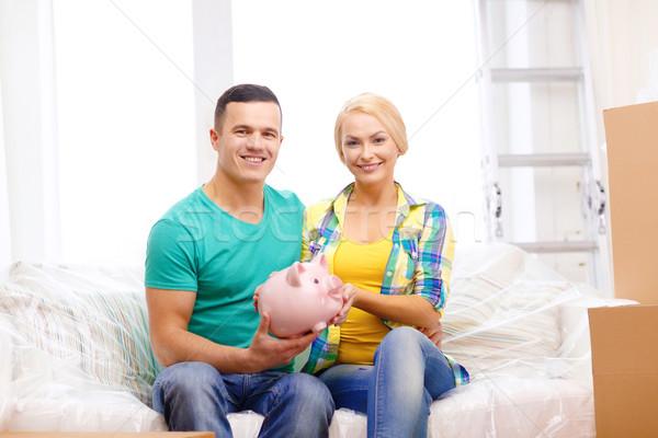Mosolyog pár persely új otthon mozog otthon Stock fotó © dolgachov