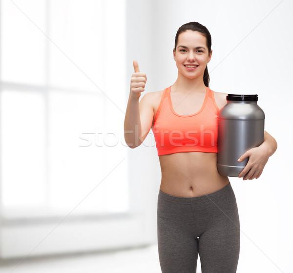 Stockfoto: Tienermeisje · jar · eiwit · tonen · fitness