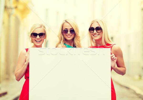 three happy blonde women with blank white board Stock photo © dolgachov