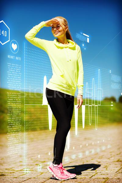 woman doing sports outdoors Stock photo © dolgachov