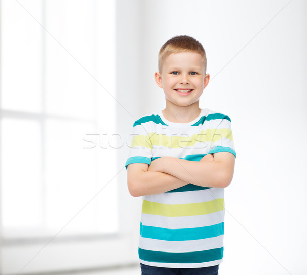 little boy in casual clothes with arms crossed Stock photo © dolgachov