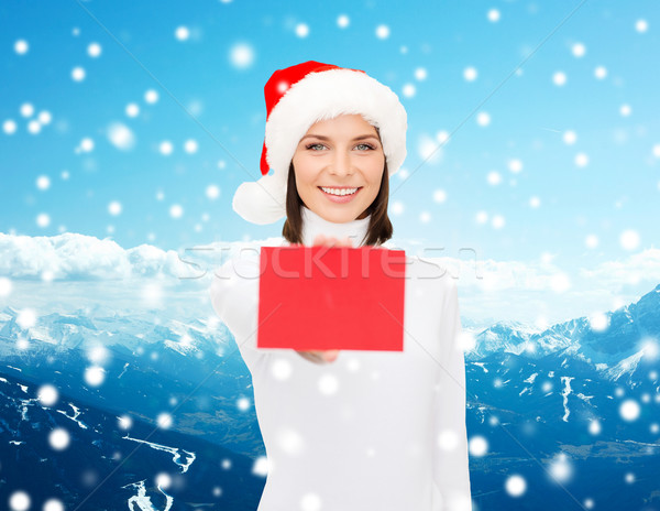 woman in santa helper hat with blank red card Stock photo © dolgachov