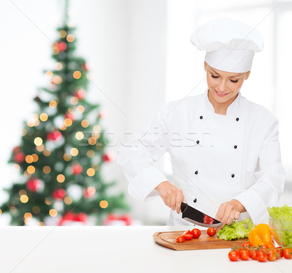 Souriant Homme chef légumes cuisson Photo stock © dolgachov