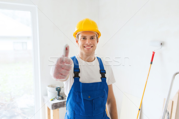 Sorridente jovem construtor capacete de segurança Foto stock © dolgachov
