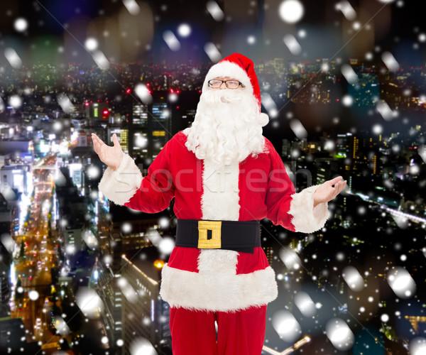 man in costume of santa claus Stock photo © dolgachov