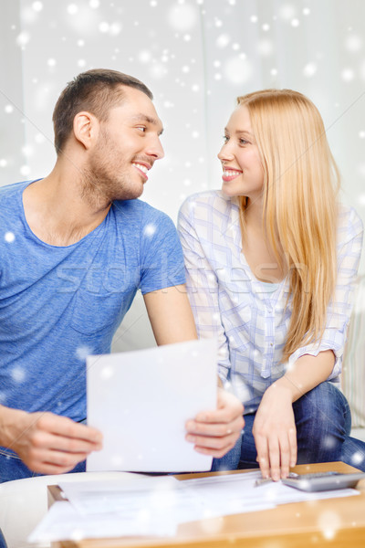 happy couple with papers and calculator at home Stock photo © dolgachov
