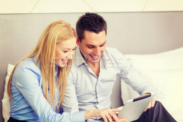 couple with tablet pc computer in hotel room Stock photo © dolgachov