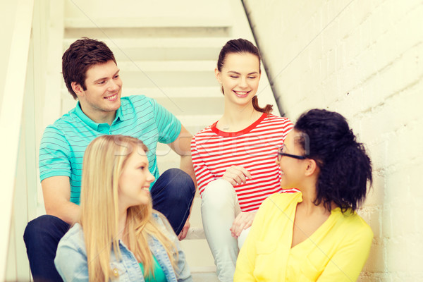 Stock photo: smiling teenagers hanging out
