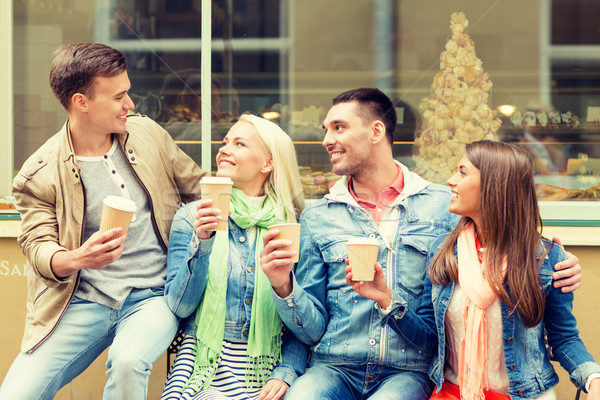 group of smiling friends with take away coffee Stock photo © dolgachov