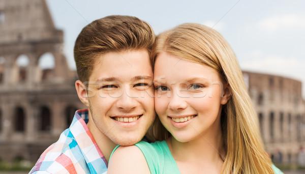 smiling couple over coliseum background Stock photo © dolgachov
