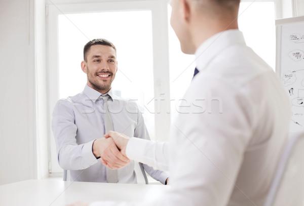 Zwei lächelnd Geschäftsleute Händeschütteln Büro Business Stock foto © dolgachov