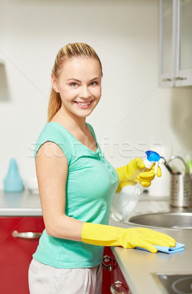 happy woman cleaning table at home kitchen Stock photo © dolgachov