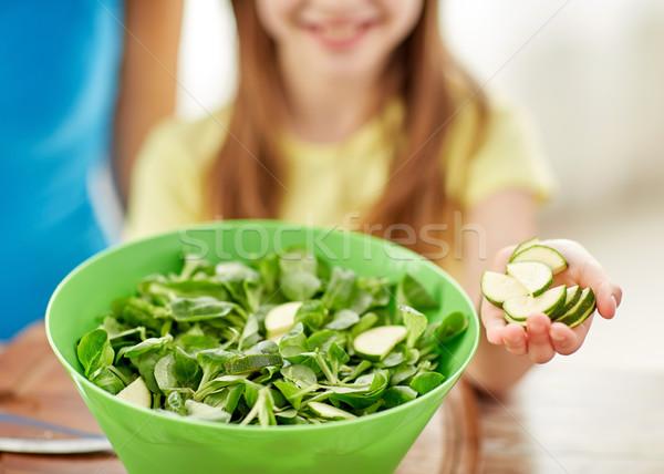 close up of happy family making dinner in kitchen Stock photo © dolgachov