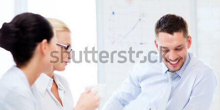 two businesswomen having discussion in office Stock photo © dolgachov