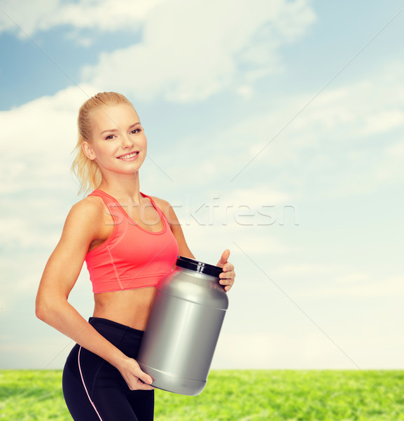 Souriant femme jar protéines fitness Photo stock © dolgachov