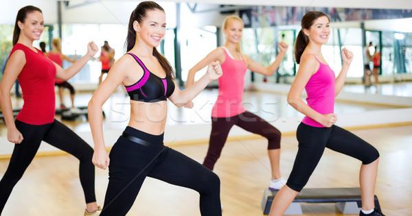 Csoport mosolyog emberek aerobik fitnessz sport Stock fotó © dolgachov