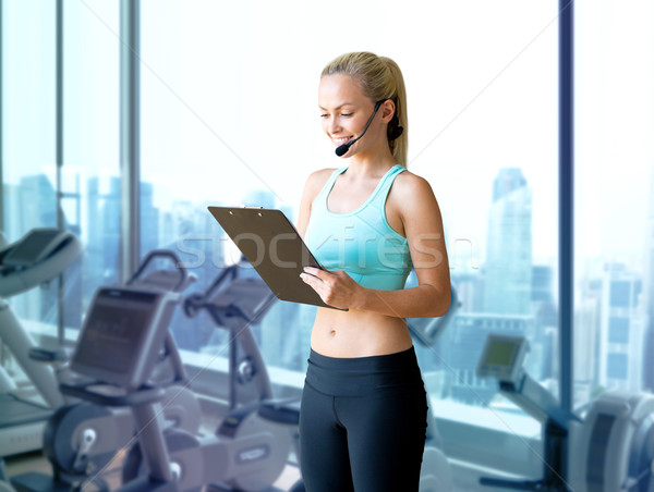 happy woman trainer with microphone and clipboard Stock photo © dolgachov