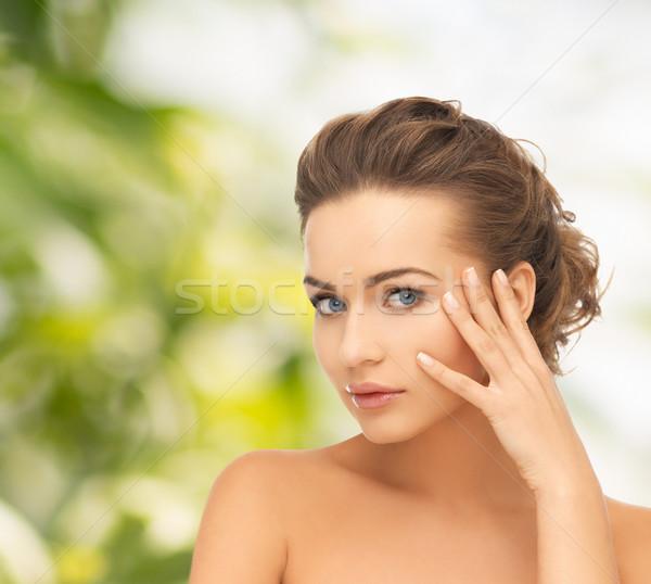 beautiful woman with updo Stock photo © dolgachov