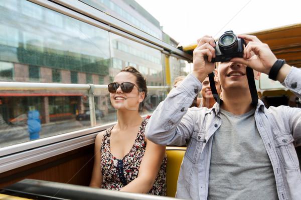 Stok fotoğraf: Gülen · çift · kamera · tur · otobüs