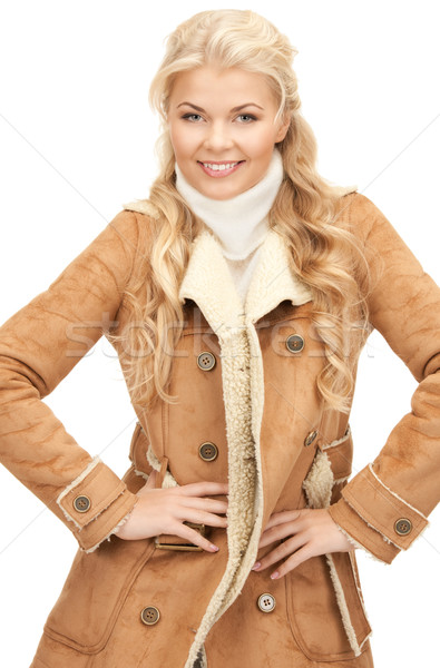 beautiful woman in sheepskin jacket Stock photo © dolgachov